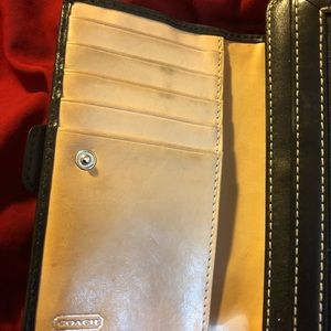 Coach wallet in EUC.Back with off white stitches.